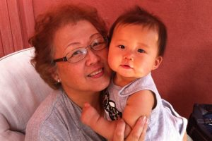 Nadine Shiroma and her grandchild.
