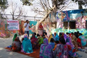 Volunteers from the Rann India Foundation teach villagers about hepatitis B testing and prevention in India.